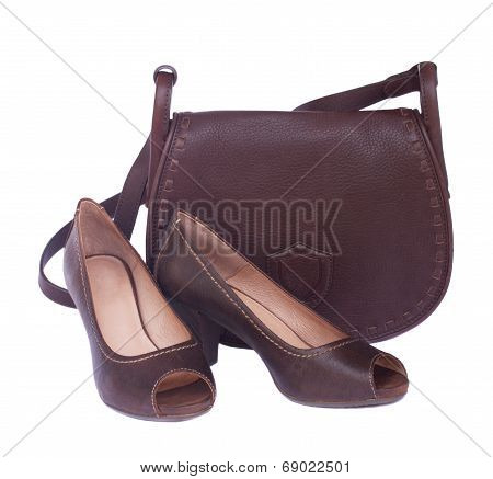 brown female bag with shoes and scarf