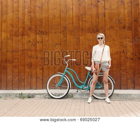 Young Sexy Blonde Girl With Long Hair In Green Sunglasses Standing Near Vintage Green Bicycle Have F