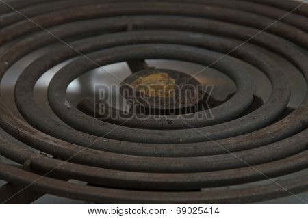 Close Up Of Coiled Heating Element On Stove