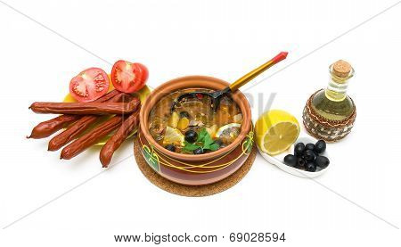 Dish Of Russian Hodgepodge Soup In Ceramic Pot On A White Background.