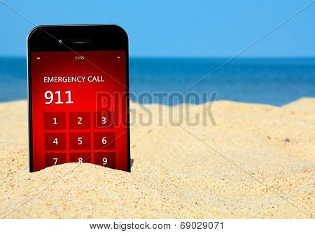 Mobile Phone With Emergency Number 911 On The Beach
