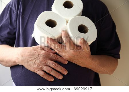 Man With Upset Stomach Holds Toilet Paper