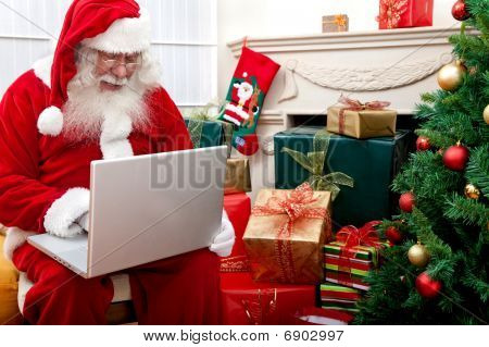 Santa Claus With A Laptop