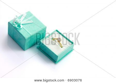 Diamond Ring In Green Gift Box Isolated On White With Copyspace