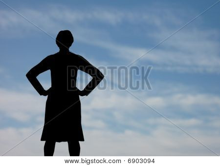 Powerful woman with sky