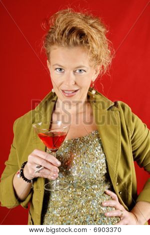 Beautiful Blond Woman With Red Drink