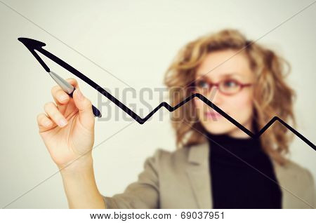 Businesswoman Drawing Graph With Pen