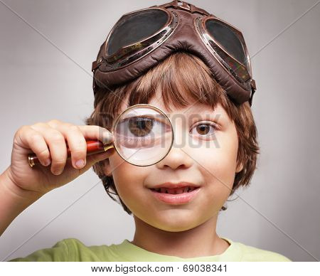 happy boy with magnifying