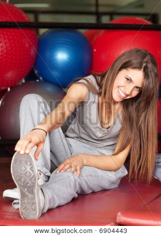 Happy Young Women In The Gym Stretching