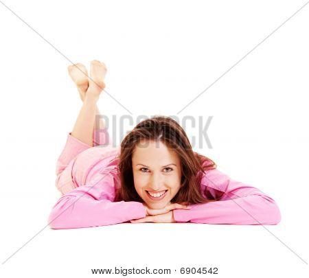 Smiley Woman In Pink Pyjamas Lying On The Floor