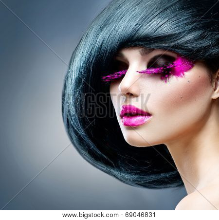 Fashion Brunette Model Portrait. Hairstyle. Haircut. Professional Makeup. False pink feather Eyelashes. Purple Lipstick. Make-up. Hairstyle. Haircut. Hairdressing. Fashion Art. Vogue Style