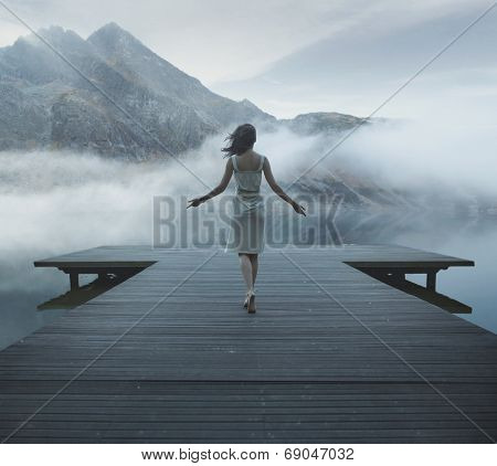 Woman on a wooden bridge poster