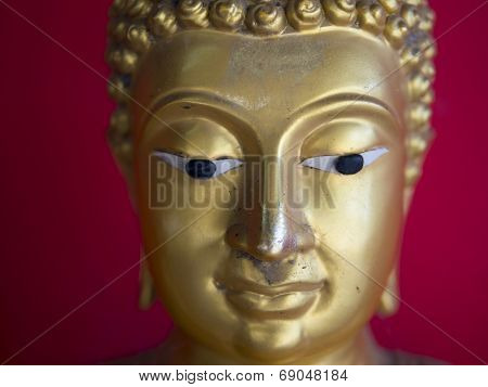 Head Of Buddha Statue Over Vibrand Red Background