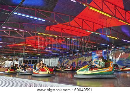 Some People Having Fun To  Drive A Bumper Car In The Amusement Park