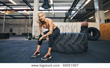 Crossfit Woman Taking Break At Gym