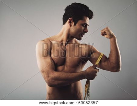 Muscular Male Measuring Biceps