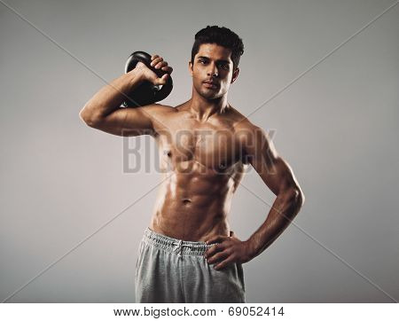 Young Muscular Man Doing Crossfit Workout