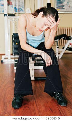 Tired Sportswoman In Sports Hall