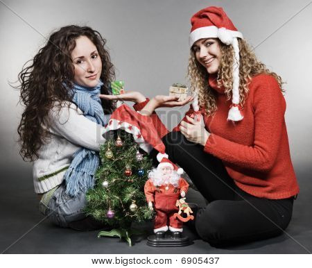 Two Friends Sitting Near Christmas Tree