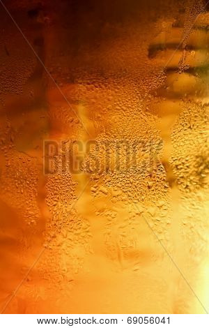 Detail glass of beer with bubbles
