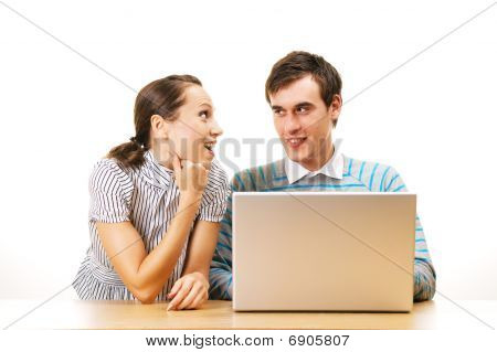 Two Smiley Students With Laptop