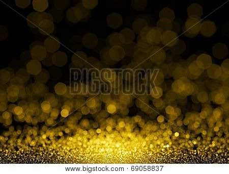 Defocused gold sparkle glitter lights background. Glitter bokeh background
