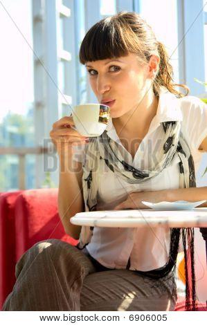 Woman Drinking Hot Coffee