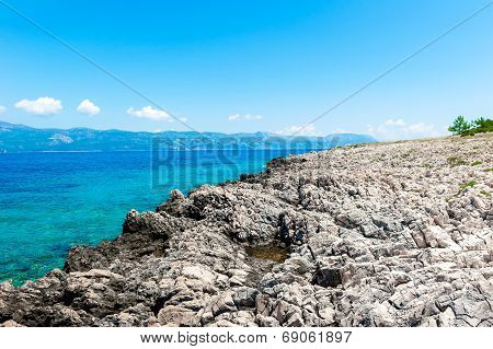 Rocky Coast Of Korcula On The Adriatic Sea In Croatia