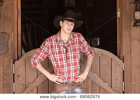Cowboy in hat standing near saloon entrance