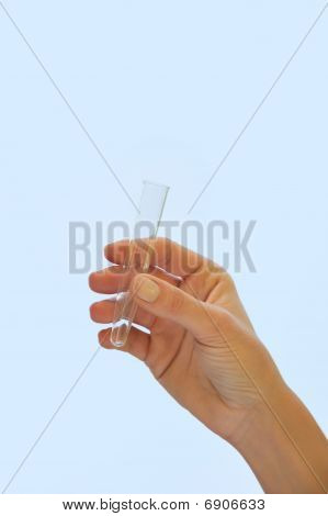 Hand holding test tube - isolated