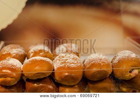 Backed Yeast Bun Row With Powdered Sugar
