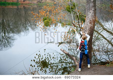 Girl Traveler With Bungee In The Hands Near Autumn River