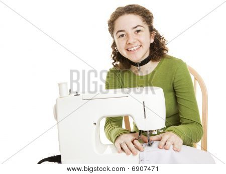 Teen Girl Enjoys Sewing