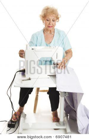 Senior Woman Sewing Full Body