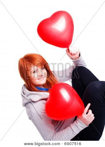 Teenager Girl Holding Two Valetine Balloon Hearts Over White