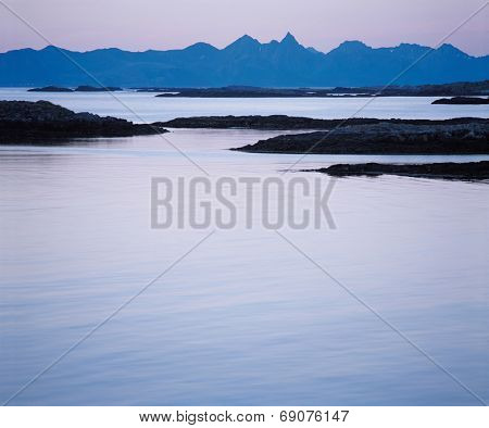 Calm Water and Distant Mountains
