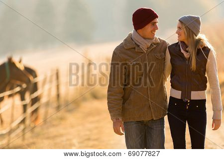 adorable young couple walking in countryside