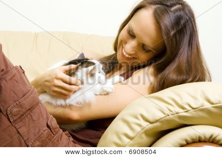 Woman With Her Pet At Home