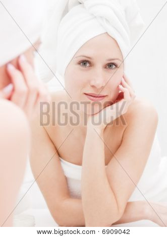 Young Woman After Shower Looking At Her Reflection