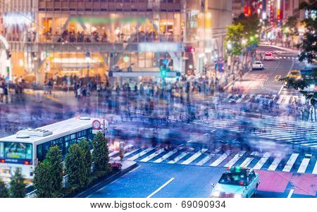 People And Traffic Crossing The Famous Shibuya Intersection