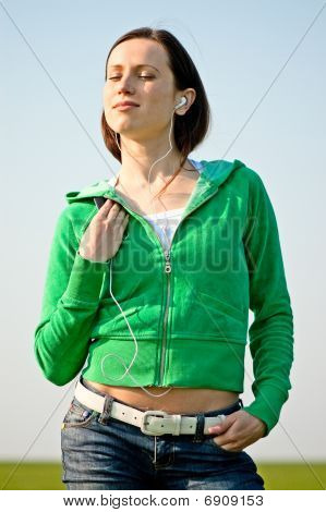 Young Woman With Earphones