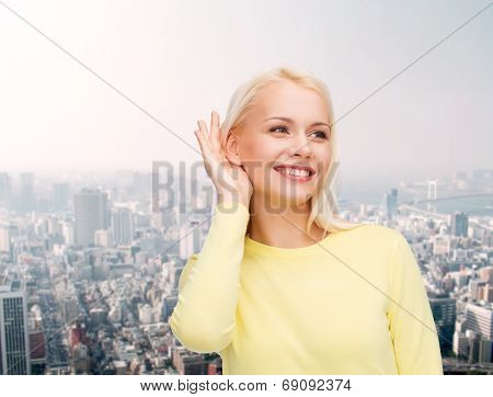 gossip, communication and people concept - smiling young woman listening to gossip