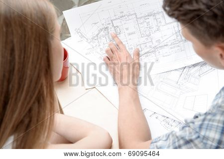 Two young architectures working at projective drawing