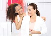 picture of covenant  - Two women shopping in boutique clothing - JPG