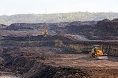 image of open-pit mine  - open coal mining pit with heavy machinery - JPG