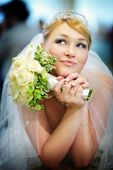 foto of flower girl  - Beautiful bride in a wedding dress with bouquet of flowers - JPG
