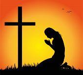 foto of crucifix  - silhouette of woman praying before the crucifix - JPG