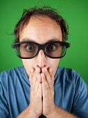 picture of shock awe  - Thirty year old man with 3d glasses in shock watching a movie over a green background - JPG