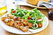 stock photo of rocket salad  - Grilled chicken skewer with rocket salad by bread - JPG