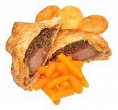 stock photo of beef wellington  - Traditional beef Wellington cut in half with filling exposed - JPG
